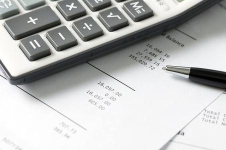 financial market: Close up of calculator and pen on financial budget statement Stock Photo