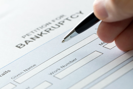moneyless: Close up of a person filling petition of bankruptcy form