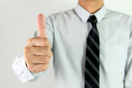 feeling up: Close up of businessman showing thumb up