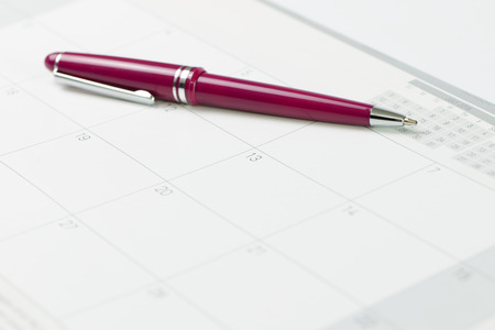 ball point: Red ball point pen on empty calendar