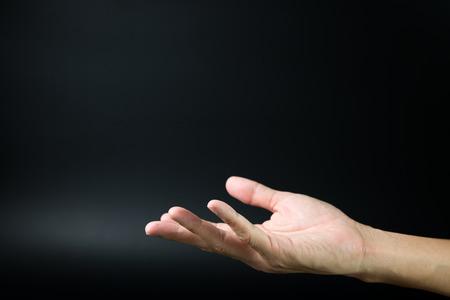 Close-up van de open hand op een zwarte achtergrond Stockfoto