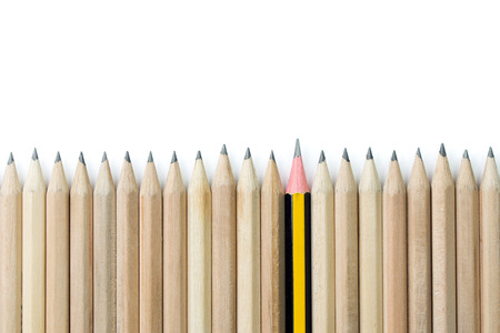 great job: One pencil standing out from the row of brown pencils Stock Photo