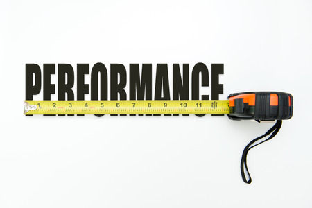 measure: Measuring tape over the word performance on white background Stock Photo
