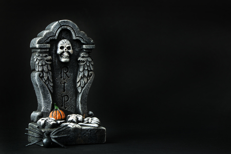 halloween message: Halloween RIP tombstone with spider on black background