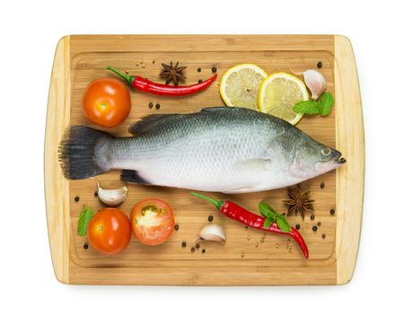 raw fish: Fresh raw fish with ingredients on chopboard Stock Photo