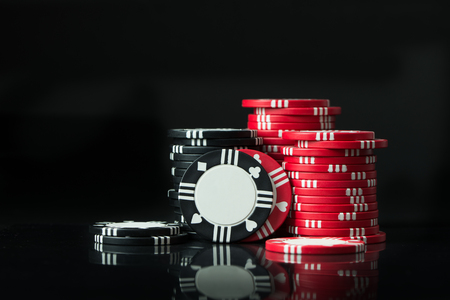 Stacks of poker chips isolated on black background 스톡 콘텐츠