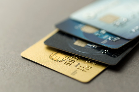 Close up of credit cards over grey background Archivio Fotografico