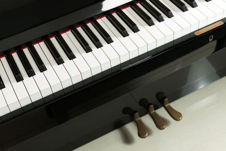 Close up view of piano with pedal