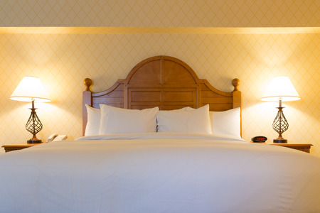 honeymoon suite: Interior of luxury double beds in hotel bedroom