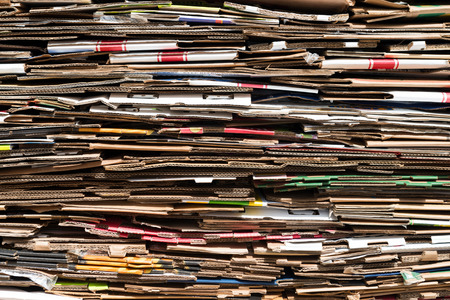 Pile of old cardboard boxes forming background Stock Photo