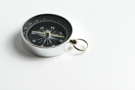Black compass instrument isolated on white background Foto de archivo