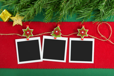Polaroid photo frames hanging on rope over Christmas background