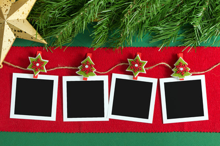 Polaroid photo frames hanging on rope over Christmas background
