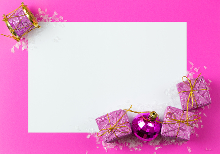 the end of the year: Blank card with Christmas ornaments decoration on pink background Stock Photo