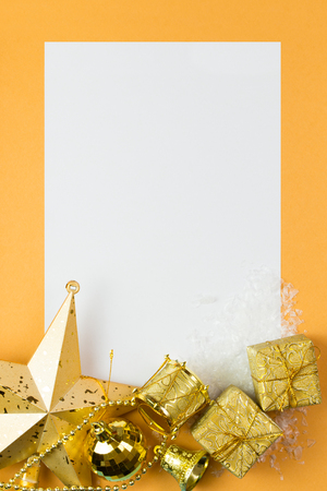 christmas card: Blank card with Christmas ornaments decoration on golden color background