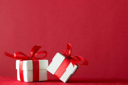 box design: Two gift boxes wrapped with ribbon on red background