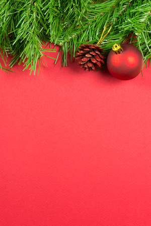 Christmas decoration over red background, with copy space