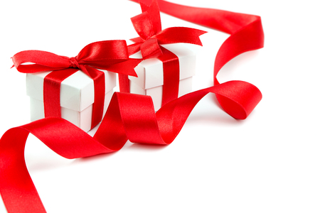 gift boxes: Gift boxes with red ribbon and bow on white background, with copy space