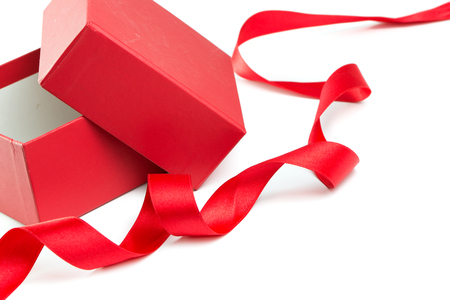 red gift box: Opened red gift box and satin ribbon on white background, with copy space Stock Photo
