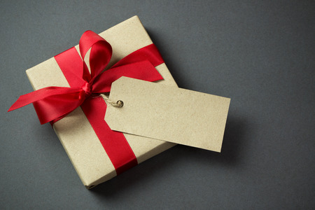 tag: Rustic gift box with empty tag and red bow