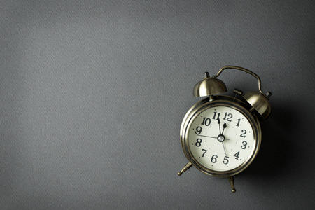text space: Alarm clock showing almost 12 o clock, with copy space Stock Photo