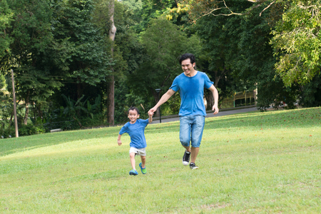 Portrait of father and son in the park Stock Photo