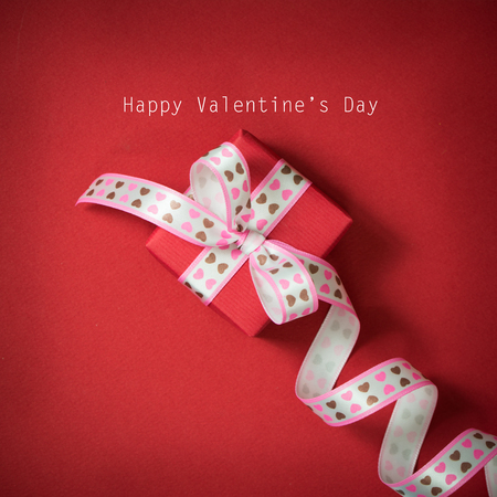 red gift box: Happy Valentines day with a red gift box Stock Photo