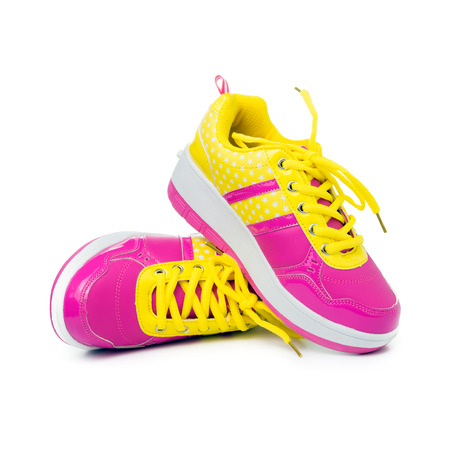 women sport: Pair of pink sport shoes on white background Stock Photo