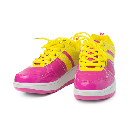 modern girl: Pair of pink sport shoes on white background Stock Photo