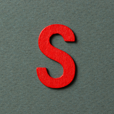 s alphabet: Wooden textured red color alphabet S in grey background