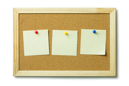 post it notes: Three blank post it notes on a cork notice board Stock Photo