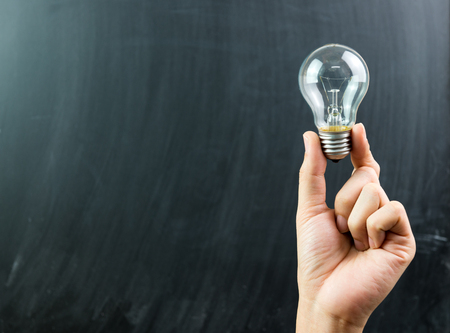 innovation concept: Innovation or creative concept with a hand hold a lightbulb