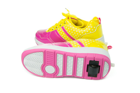 girl shoes: Pair of pink heelys on white background