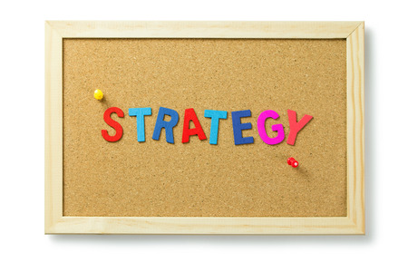 Strategy word letters on cork notice board