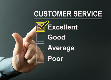 customer satisfaction: Excellent customer service survey with a businessman hand Stock Photo