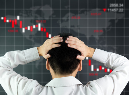 economic depression: An investor is looking at screen showing stock market crash Stock Photo