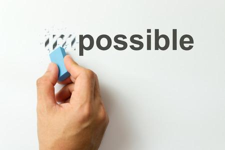 Veranderen van het woord onmogelijk mogelijk een gom Stockfoto