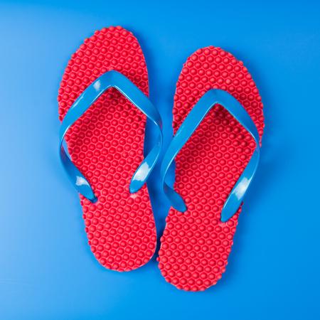 flipflops: Pair of red flip flops on blue background