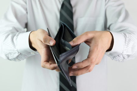 with no money: Business man showing an empty wallet for no money concept