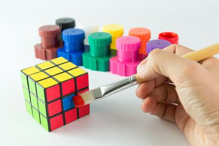 Penang, Malaysia - September 20, 2015: Creative solution or shortcut conceptual using paint brush and rubik cube