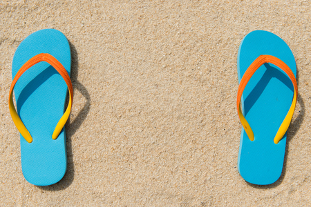 flipflop: Pair of blue flipflop on beach with copy space