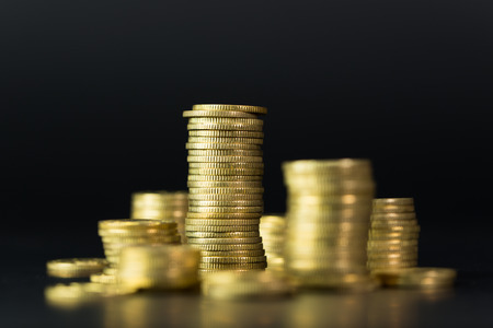 Stack of gold coins in dark background