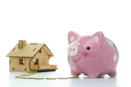 finance concept: Pink piggy bank with a house for home finance concept Stock Photo
