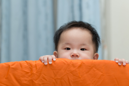 parents with baby: Portrait of an asian baby in playpen