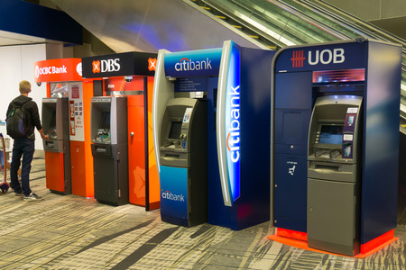 automatic machine: Singapore - March 16, 2016: Various bank ATM at Singapore Changi International airport