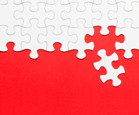 puzzle background: White jigsaw puzzle form with red background