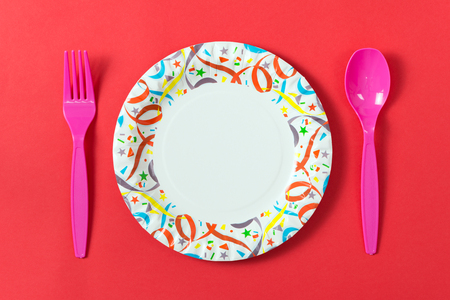 Party paper plate with plastic spoon and fork