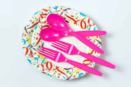 background settings: Party paper plate with plastic spoon and fork