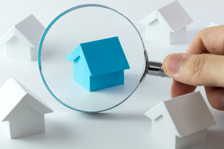 House searching concept with a magnifying glass