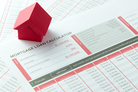 sheet: Mortgage loan balance sheet with a miniature red paper house Stock Photo